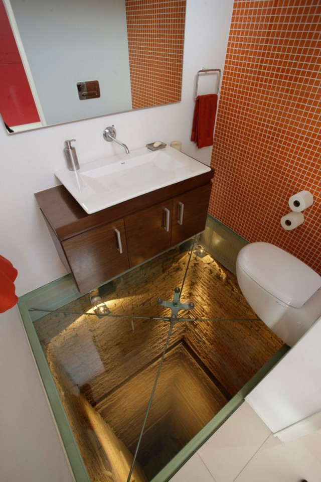 A Bathroom Situated Atop a 15-Story Elevator Shaft