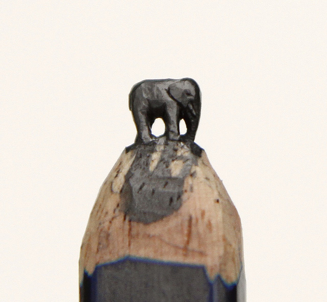 A Raven and Elephant Carved from Graphite Pencil Tips by Diem Chau