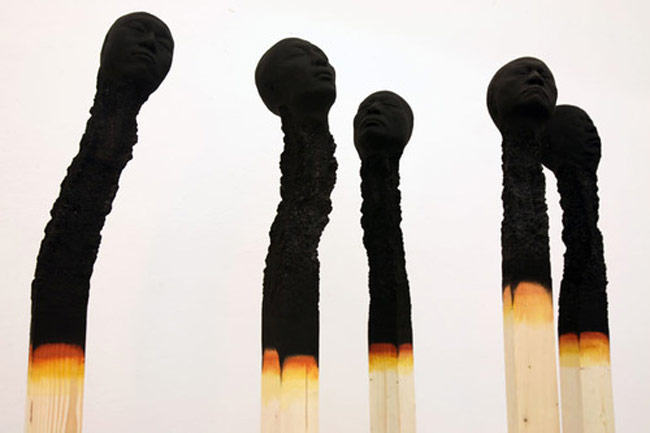Giant Matchsticks With Creepy Human Heads