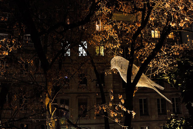Illuminated Wire Bird Sculptures Perched on Trees