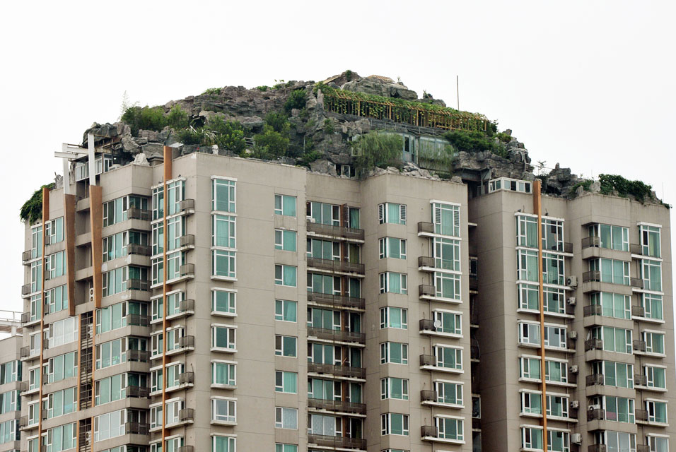 Beijing man builds rock villa on top of apartment tower