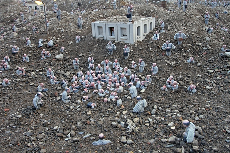 A Corporate City in Ruins by Isaac Cordal