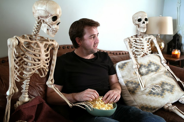 Man Lives Everyday Life With Plastic Skeletons in Photo Series