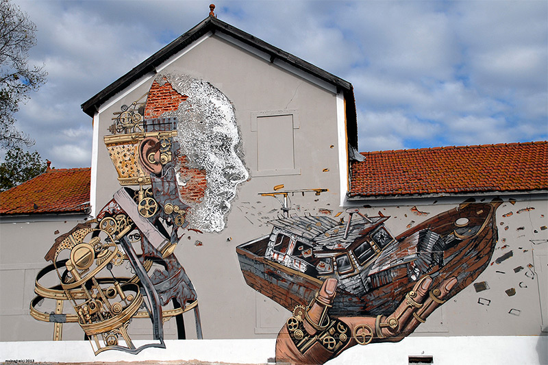 New Mural in Lisbon, Portugal by Vhils & Pixel Pancho