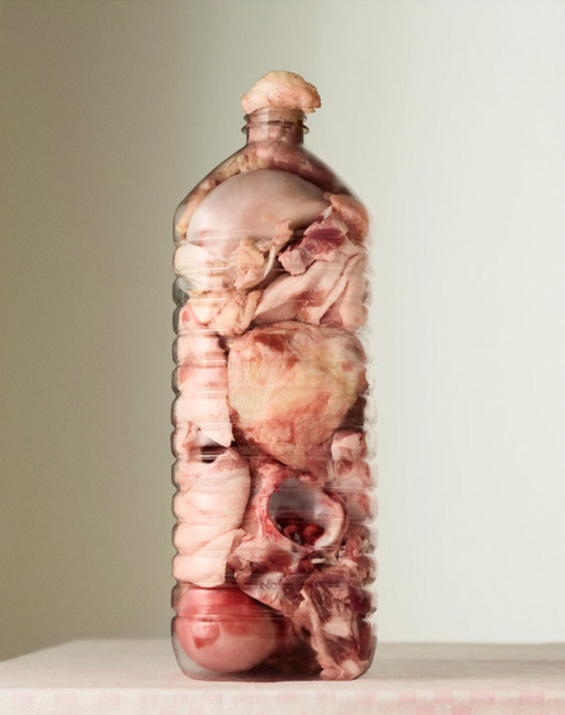 Per Johansen's Grotesque Photographs Of Meat Stuffed Into Bottles