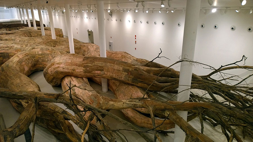 Artist Uses Repurposed Wood To Build Giant Root-like Tunnels You Can Explore From The Inside