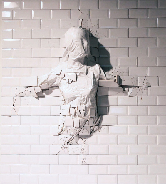 Graziano Locatelli's Sculptures Emerge From Beneath The Walls