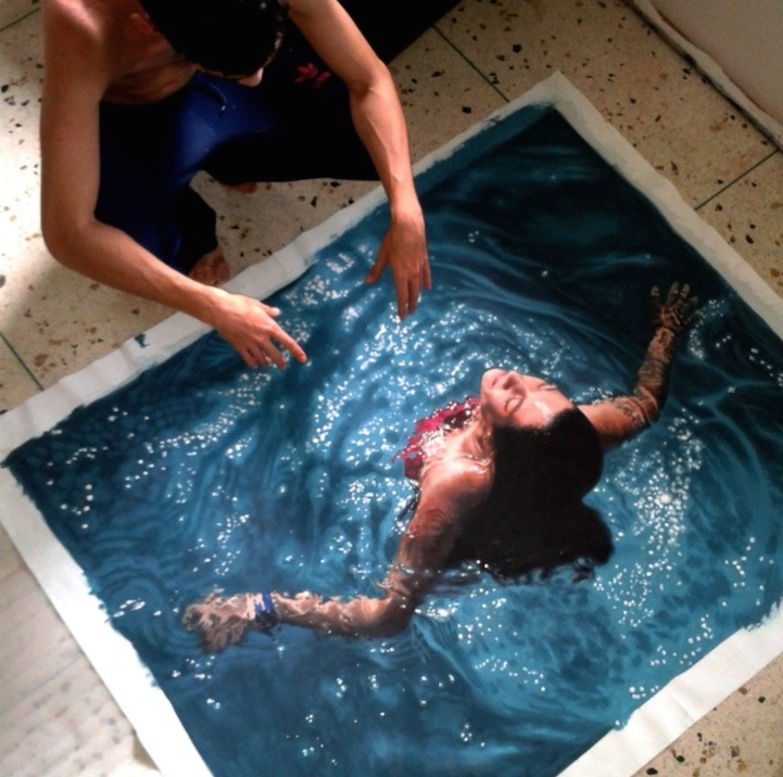 Artist Poses Creatively With His Own Hyperrealistic Paintings of People Swimming