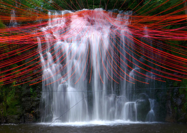 'Dripping', A Beautiful Installation of Red Strings Extending Gracefully From a Waterfall in France