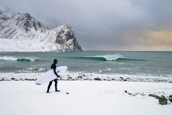 Chris Burkard's Breathtaking Photos Of People Surfing Among Glaciers And Snow
