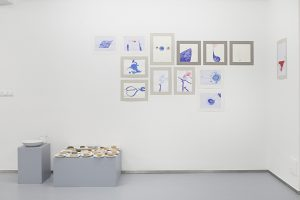 Exhibition view. From left to right: Ana Adam, It rains inside me just as much as needed, installation, 30 soaps, 2017-2018; Ana Adam, Blood, Stop, Space, Gold, series of drawings, 2017-2018, variable dimensions, ink on paper. Photo credit: Javier Lamela
